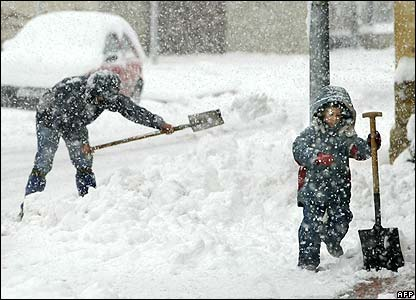 A child helps clear snow in the village of Mungia, in Spain's northern Basque region