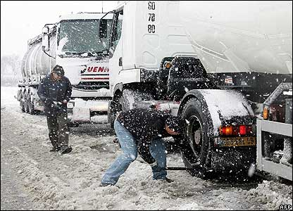 Truck driver tends to his vehicle in eastern France