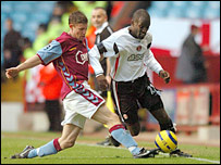 James Milner and Chris Powell tussle for possession