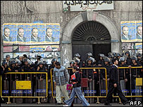 Egyptian riot police block the entrance of a polling station in Alexandria
