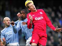 Danny Mills and Sylvain Distin of Manchester City and Liverpool's Peter Crouch