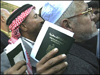 Palestinians wait for their passports to be checked at Rafah terminal