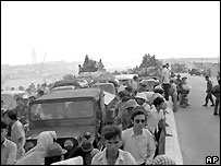 Refugees fleeing the advance of communist forces create a massive traffic jam on the northern outskirts of Saigon, late April 1975