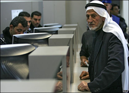 Palestinian waits for his passport to be checked at Rafah terminal