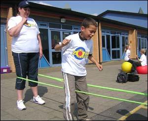 Boy playing elastics