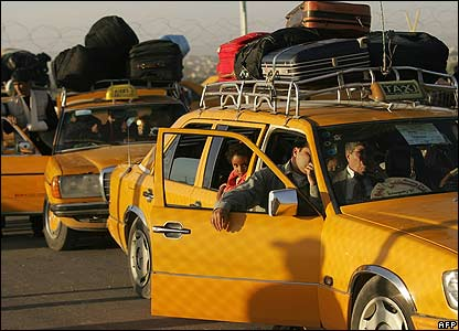 Taxis carry Palestinian passengers who have crossed the border between the Gaza Strip and Egypt