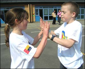 Boy and girl carrying out hand-clapping routing