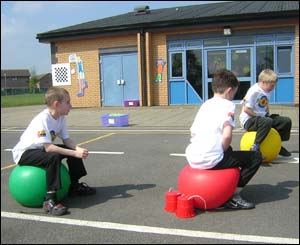 Boys on inflatable hoppers