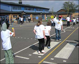 Children playing with long skipping rope.
