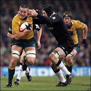 Australia's Hugh McMeniman (L) is tackled by Michael Owen