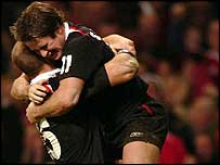 Gareth Thomas and Shane Williams celebrate the winger's stunning try