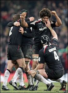 Wales' players celebrate at the final whistle