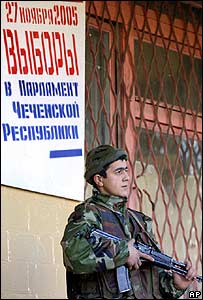 Guard outside a Grozny polling station