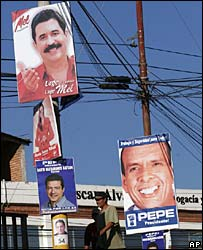 Election posters in Honduras for Manuel Zelaya (top) and Porfirio Lobo