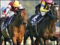 Frankie Dettori and Alkaased (left) fight it out with Heart's Cry as the finishing post looms