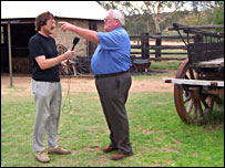 Paul Davies, interviewing Bruce McCrea, a guide at the Alice Springs Telegraph station (BBC)