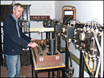 Alan Renton, curator of the Porthcurno Telegraph Museum in the cable hut (BBC)