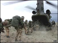 Marines board a helicopter
