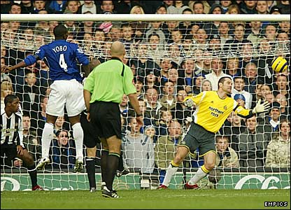Everton's Joseph Yobo scores past Shay Given with a header from a corner
