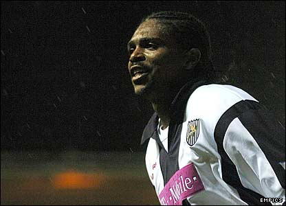 Kanu celebrates West Brom's second goal