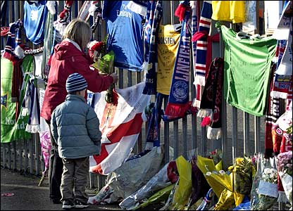 Fans hang scarves and flowers on the gates to Windsor Park where Northern Ireland play their matches