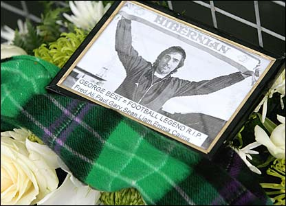 A picture is left amongst the tributes outside Easter Road