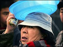 Woman with bucket in Harbin