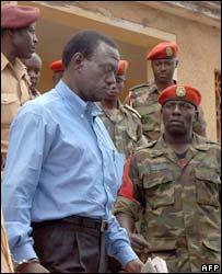 Ugandan opposition leader Kizza Besigye leaves a military court