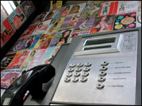 Prostitutes' calling cards on display in a phone box