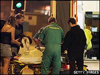Paramedics treating a reveller