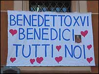 A banner from a window in Rome that says: Benedict XVI - Bless us All