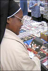 Nuns buying postcards of the new Pope