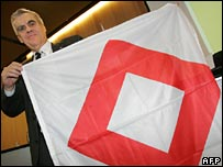 "International Red Cross Committee co-operation director Francois Bugnon with the ""Red Crystal"" emblem"