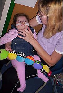 Charlotte Wyatt in her hospital room with mother Debbie