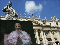 "A giant screen installed in St Peter's Square in the Vatican shows Pope Benedict XVI""s audience with international press and pilgrims"