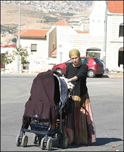 Woman with pram (photo: Noam Sharon. All rights reserved)