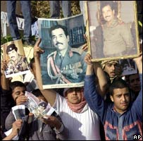 Supporters of Saddam Hussein march in Tikrit, 28 November 2005
