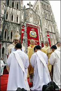 Cardinal Crescenzio Sepe (1st L) lays his hand on newly ordained priests, at Hanoi's cathedral 29 November 2005.