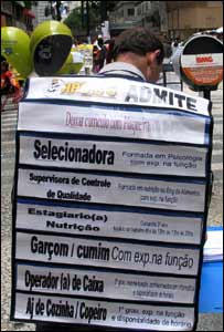 Sandwich-board man advertising job vacancies in Sao Paulo city centre