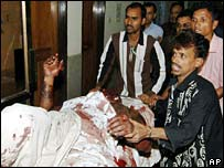 Medics carry one of the Gazipur wounded in hospital in Dhaka