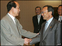 North Korean number two leader Kim Yong Nam (left) and South Korean Prime Minister Lee Hae-chan in Jakarta