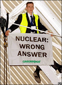 A Greenpeace protester displays a banner at the Confederation of British Industry conference