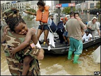 National guard troops help evacuate a family in New Orleans