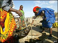 File photograph of Sudanese refugees in Chad collecting water from a well