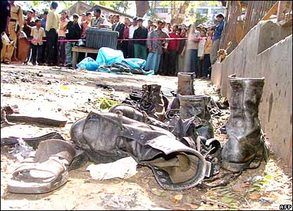 Scattered footwear and onlookers at the scene of the Chittagong attack