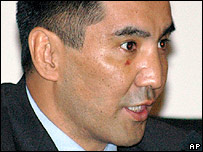 Kyrgyz lawmaker Bayaman Erkinbayev speaks during a parliament session in Bishkek, in this Sept. 1, 2005 file picture
