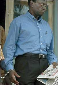 Handcuffed Kizza Besigye