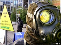 Greenpeace protester in gas mask outside CBI conference