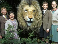(from left) Jonathan R Scott as Edmund, Sophie Wilcox as Lucy, Aslan, Richard Dempsey as Peter, Sophie Cook as Susan