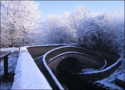 Snow outlines an unusual bridge in Cheshire